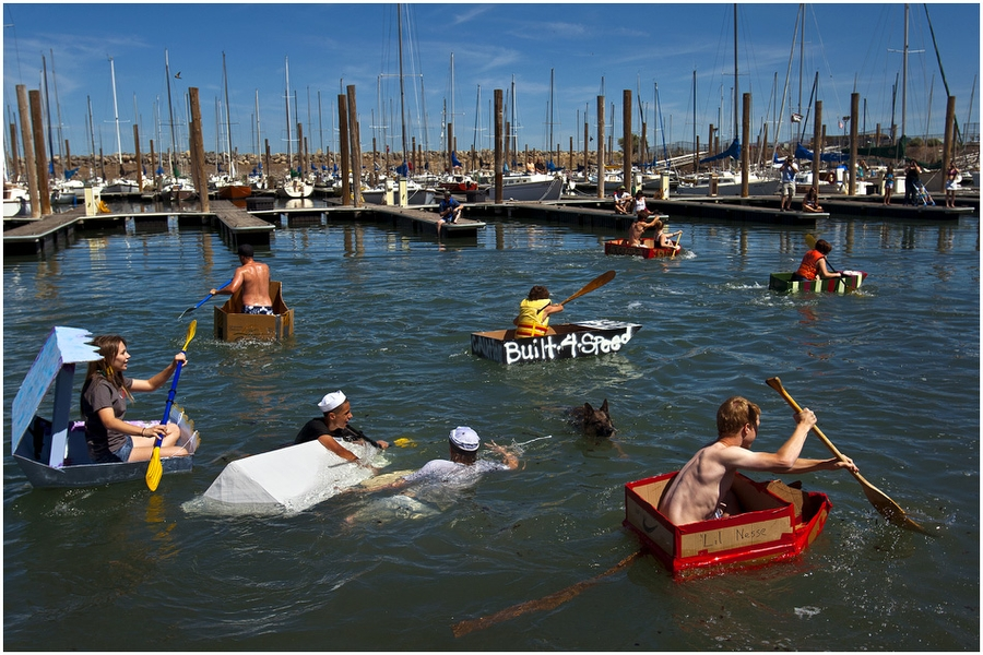 Jake Hansen and Sam Paniagua capsize their boat 'White Rhino' as other racers compete in a cardboard boat race during The Great Salt Lake Yacht Club's SailFest Saturday June 16, 2012.  Amateur boat builders of all ages designed, built and navigated boats made entirely of corrugated cardboard during the annual event hosted by the club, established in 1877.