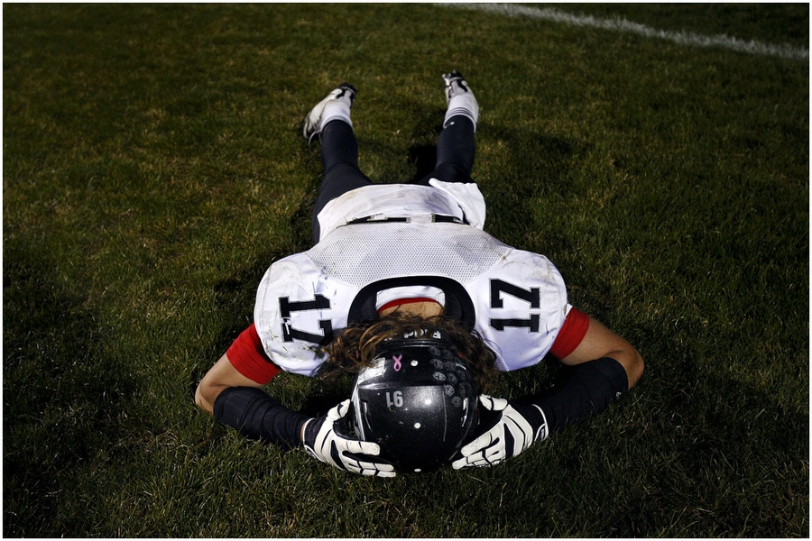 Alta's Harrison Handley (17) remains on the ground after the game at Syracuse High School Friday November 2, 2012. Syracuse won the game 31-24.