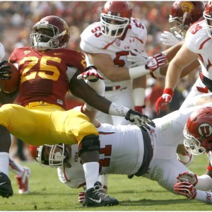 USC Trojans running back Silas Redd (25) is tackled by Utah Utes linebacker Jared Norris (41) during the first half game at the The Los Angeles Memorial Coliseum Saturday October 26, 2013. USC is winning the game 16-3.