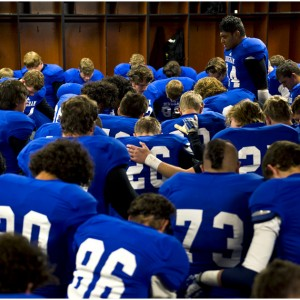 Bingham's Sione Finefeuiaki (44) leads the team in prayer before the 5A semifinal game against Lone Peak at Rice-Eccles Stadium Friday November 15, 2013.