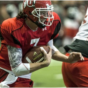 Utah Utes quarterback Travis Wilson (7) runs the ball during a practice at the Spence Eccles Field House Thursday April 12, 2012.