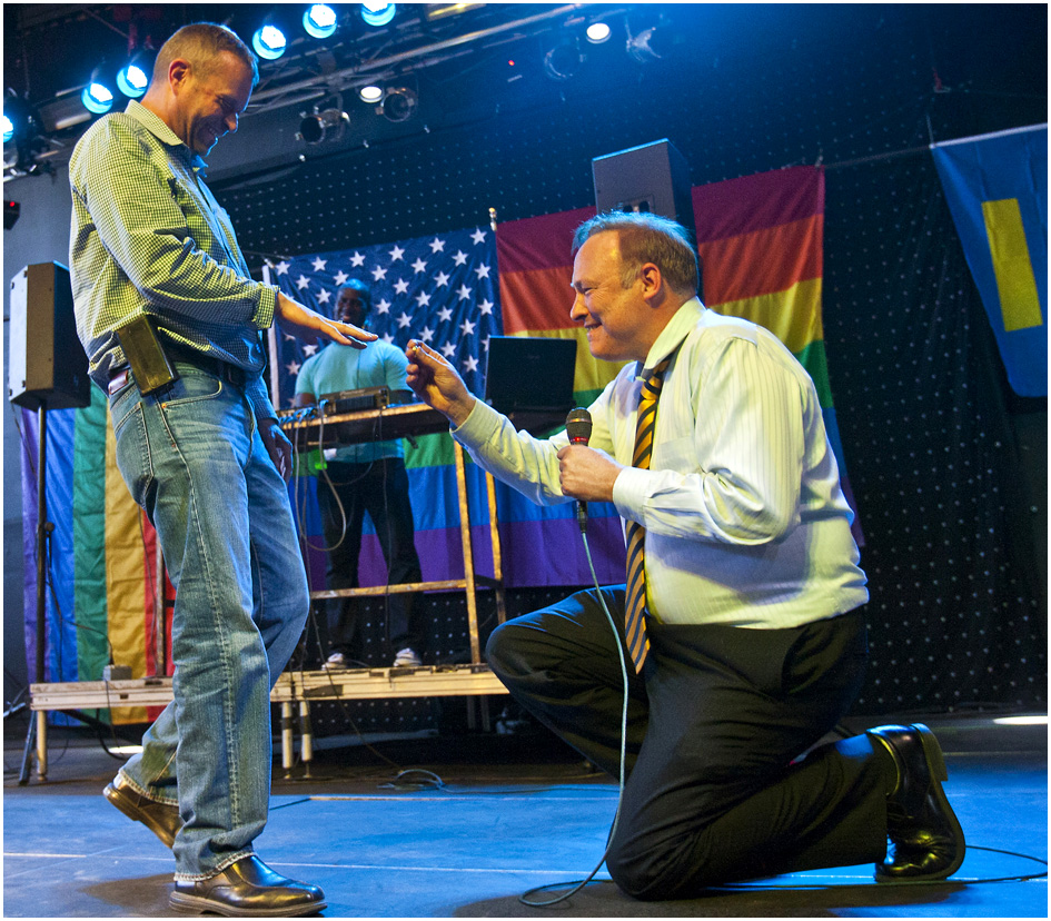 Sen. Jim Dabakis, D-Salt Lake City, proposes to Stephen Justesen, his boyfriend of over twenty-five years, during a party to show unity, love and celebrate all Utah families at Club Sound Wednesday June 26, 2013.  In historic decisions, the Supreme Court handed gay-rights supporters major victories Wednesday, extending federal rights to same-sex couples and reversing a ban on gay marriage in the nation's largest state.