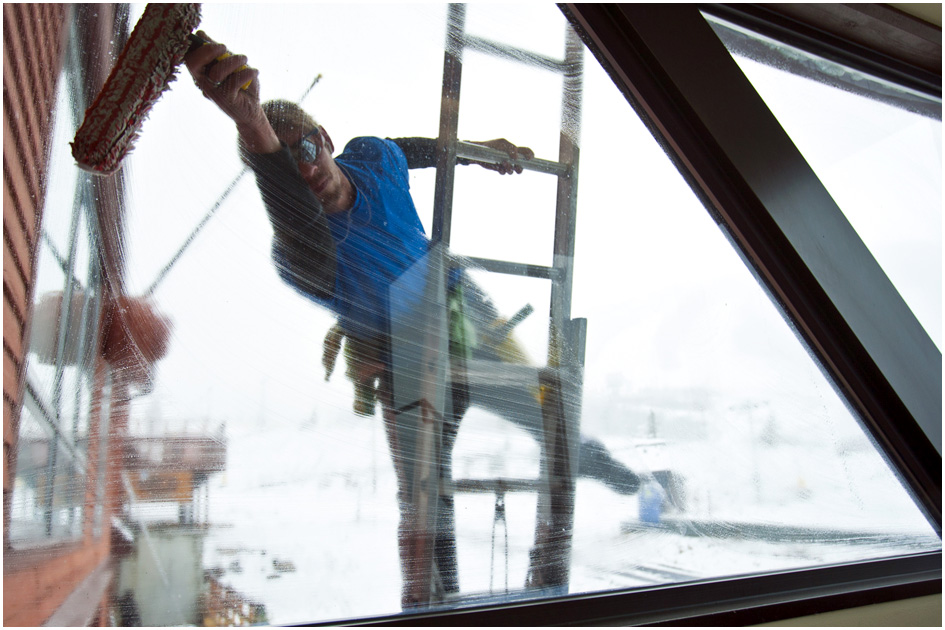 Aaron Christenson, of Better View Professional Window Cleaning, works at washing the windows at The Lodge at Park City Mountain Resort  Wednesday October 30, 2013.