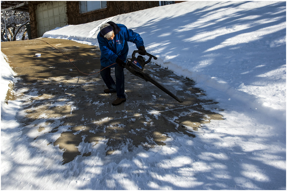 Neva Paschal, 90, uses a leaf blower to clear the snow off of her driveway in Salt Lake City Wednesday December 4, 2013.