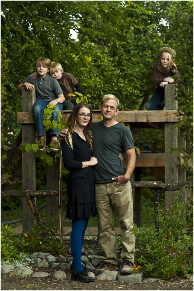 Phil Sherburne and his wife Leia Bell pose for a portrait with their kids Cortez, 11, Oslo, 6, and Ivan, 9, at their home in Salt Lake City Wednesday October 9, 2013. Sherburne and Bell, owners of the frame and art store called Signed & Numbered, succeeded last weekend in signing up for health coverage on healthcare.gov.