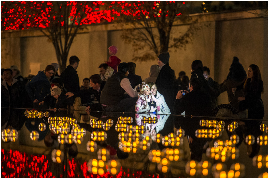 Trevor Rowe takes a picture of his wife Allison and daughter Lola, 15 months, while surrounded by the Christmas lights on Temple Square Friday November 29, 2013.  The first year the light were put up on Temple Square was in 1965. The lights will run through the end of the year.