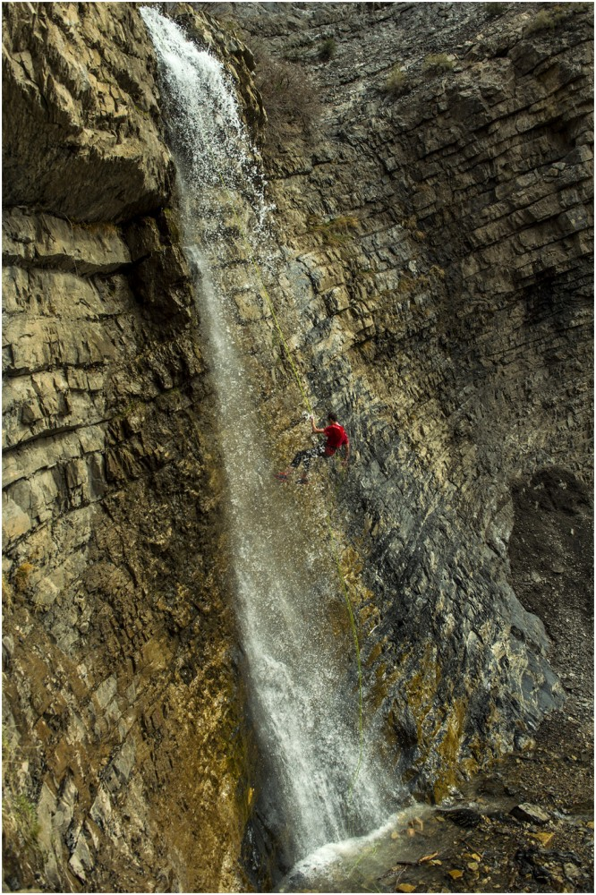 Mike Marriott, 21, of Orem, rappels down the waterfall at Battle Creek Falls near Pleasant Grove Tuesday April 15, 2014.