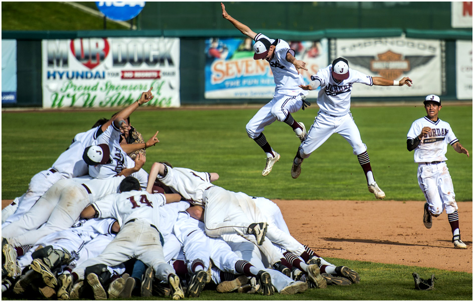 Members of the Jordan baseball team celebrate after winning the 5A state championship at Brent Brown Ballpark Friday May 23, 2014. Jordan defeated Pleasant Grove  4-3.