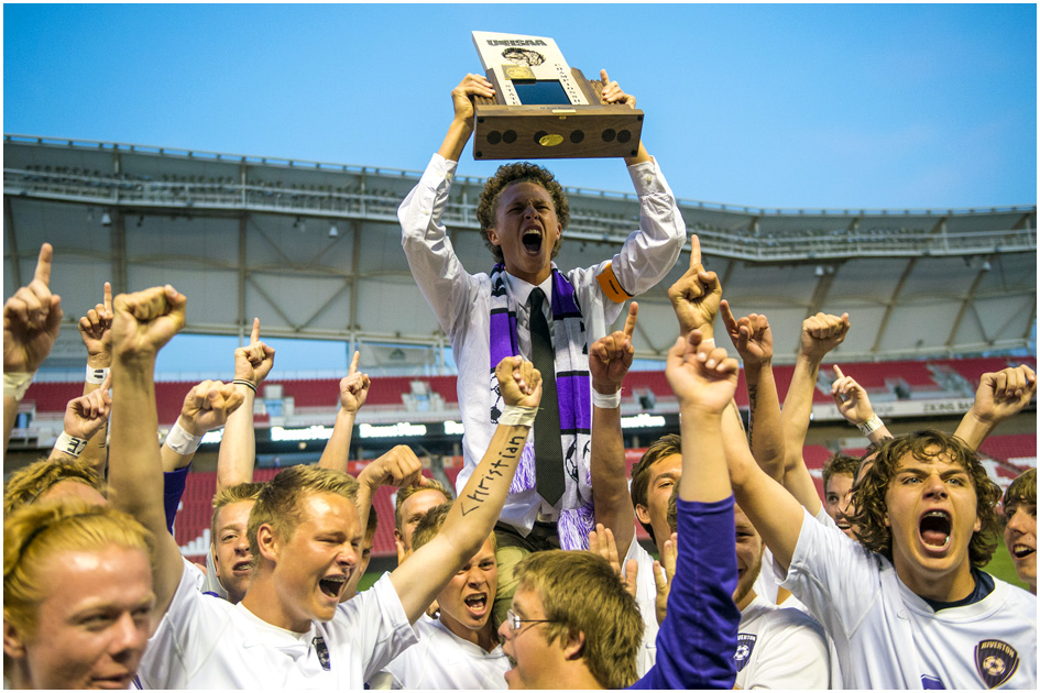 Riverton's Christian Evans (11), center, celebrates with his teammates after winning the 5A Championship game at Rio Tinto Stadium Thursday May 22, 2014. Riverton defeated Fremont 1-0.