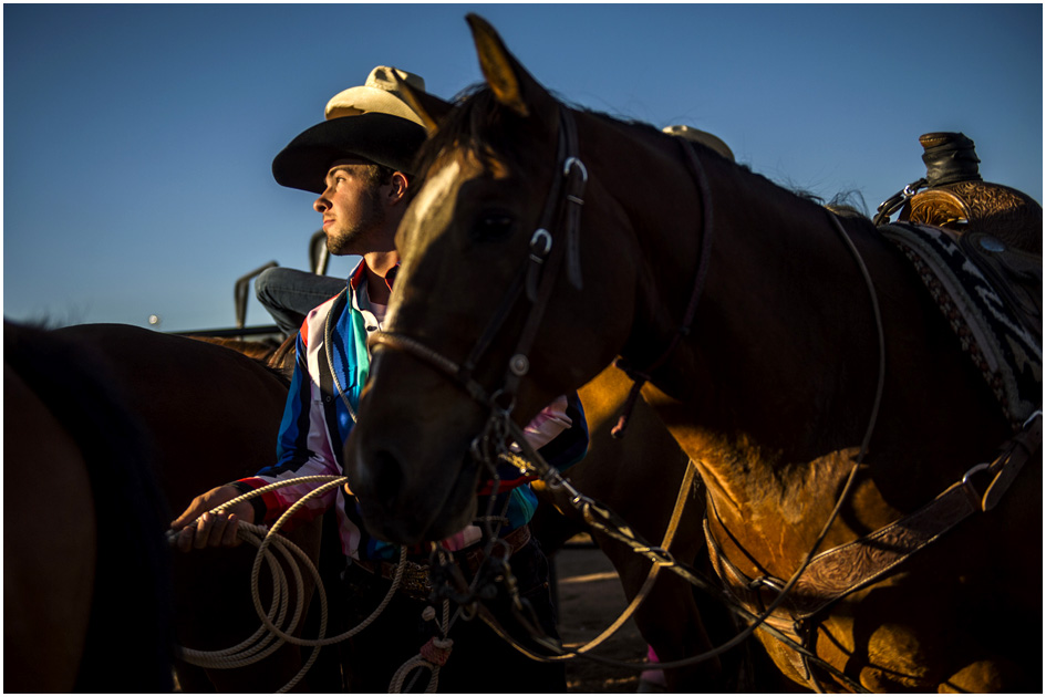 Dalton Rydalch watches other cowboys compete after competing in tie-down roping during the Utah State High School Rodeo Association Finals at the Wasatch County Event Center in Heber City Thursday June 5, 2014.