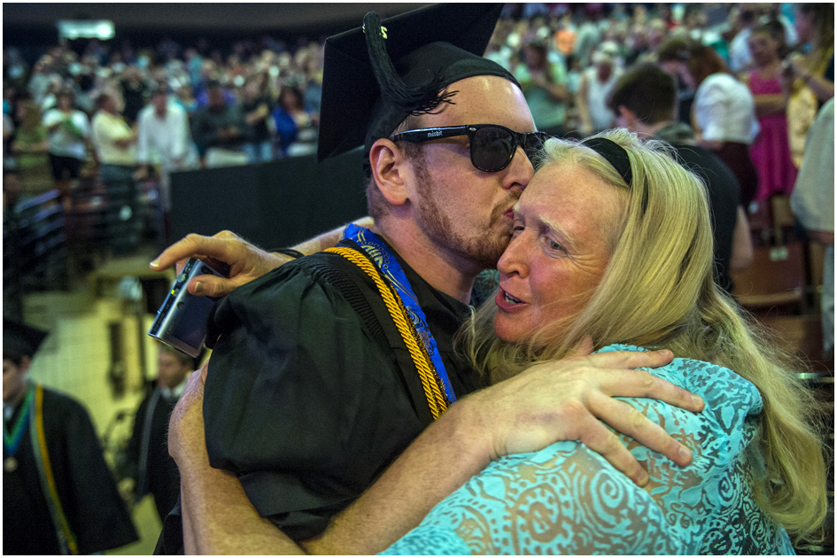 Randall Coates Nigohosian kisses his mom Margo Coates Huddleston before Westminster College's Commencement at the Maverik Center Saturday May 31, 2014. 977 students graduated. Nigohosian graduated with a bachelors in arts in special education and elementary education.