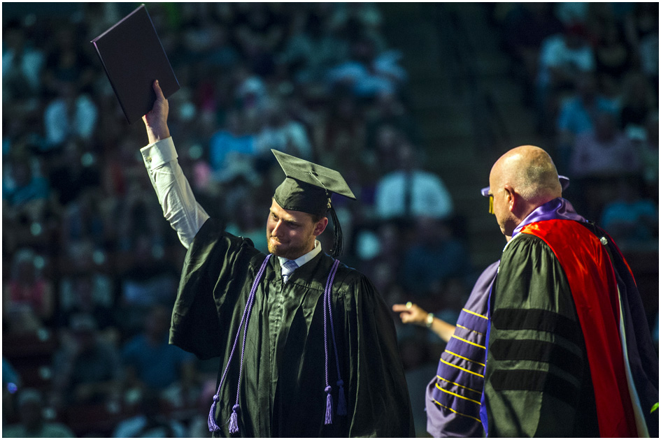 Brett Johnson celebrates after receiving his diploma during Westminster College's Commencement at the Maverik Center Saturday May 31, 2014. 977 students graduated.