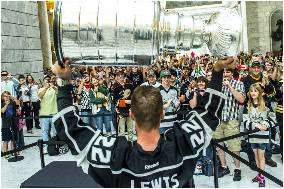 os Angeles Kings' Trevor Lewis shows off the Stanley Cup to fans at the Utah State Capitol Wednesday August 27, 2014. Lewis is a Salt Lake City native who played for Brighton's club team as a freshman in 2002. Hockey tradition dictates that each member of the winning team gets custody of the Cup for one day.