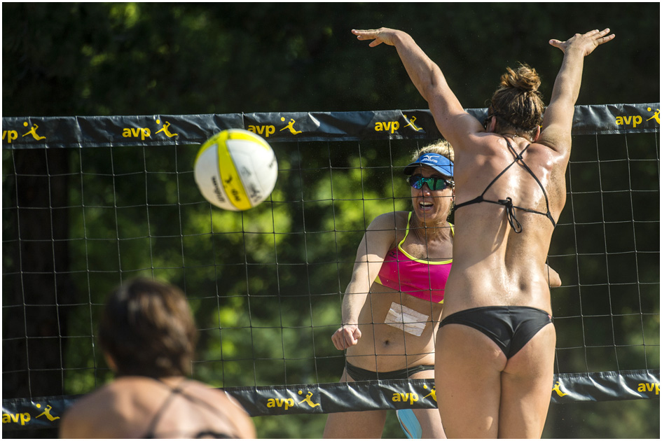 competes against Nicole Branagh, left, and Amanda Dowdy during the AVP Pro Beach Volleyball tournament at Liberty Park Saturday August 9, 2014.