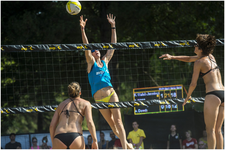 Kerri Walsh Jennings, center, competes against Nicole Branagh and Amanda Dowdy during the AVP Pro Beach Volleyball tournament at Liberty Park Saturday August 9, 2014.