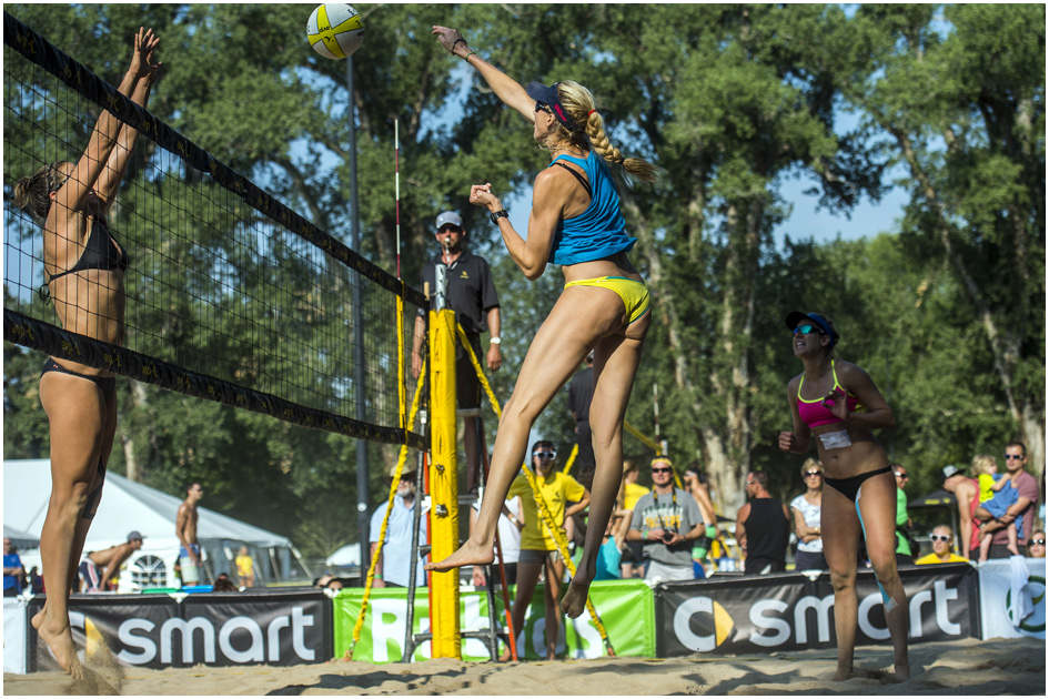 Kerri Walsh Jennings, center, and April Ross compete against Amanda Dowdy during the AVP Pro Beach Volleyball tournament at Liberty Park Saturday August 9, 2014.