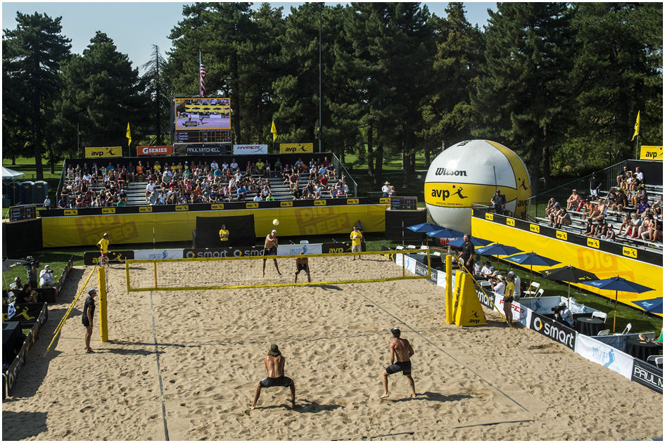 Jake Gibb and Casey Patterson, back, compete against Jeremy Casebeer and Casey Jennings during the AVP Pro Beach Volleyball tournament at Liberty Park Saturday August 9, 2014.