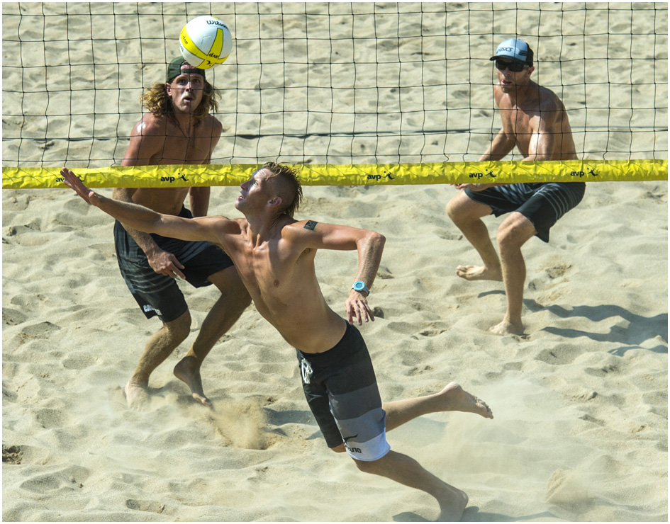 Casey Patterson dives for the ball while competing against Jeremy Casebeer and Casey Jennings during the AVP Pro Beach Volleyball tournament at Liberty Park Saturday August 9, 2014.