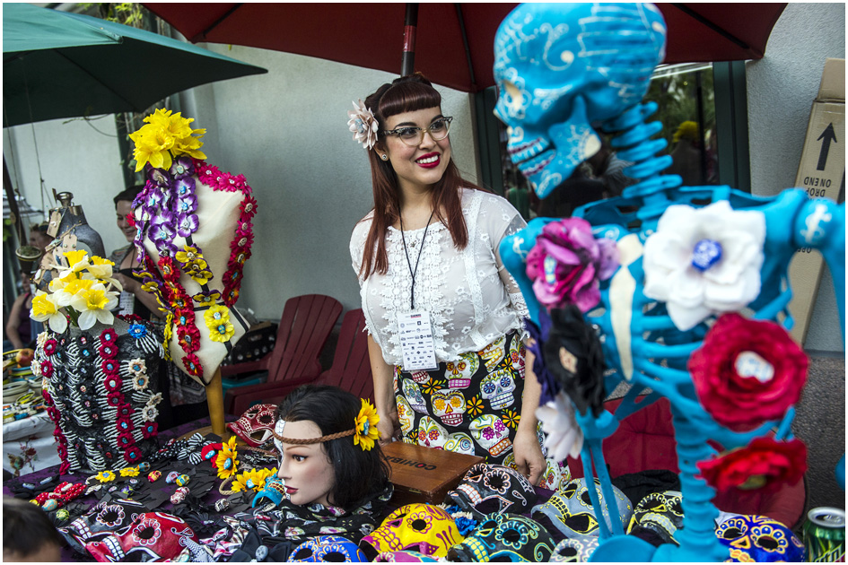 PorCause Artist Alyana DeSouza displays her Day of the Dead inspired art at Craft Lake City at the Gallivan Center Friday August 8, 2014.