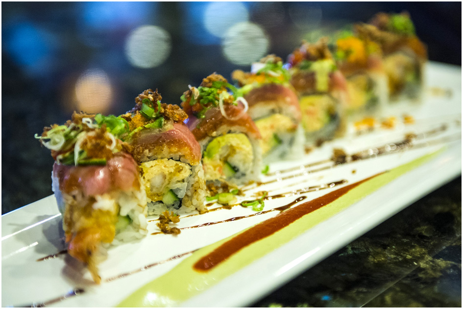 The Low Rider roll with spicy crap, tempura shrimp, avocado, cucumber, spicy tuna, yellowtail, dried shallots, jalapeño, lime, wasab and green onions ($12).