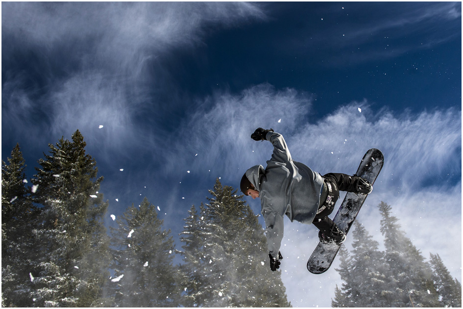 Tanner Canning, of Murray, does a backflip off a jump he and his friends built at Brighton Ski Resort Tuesday November 4, 2014.